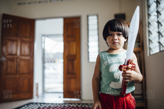 Little boy holding a toy sword