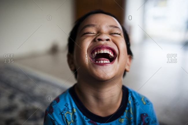 Happy boy laughing