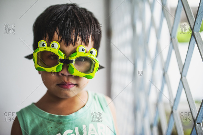 Young boy wearing frog goggles