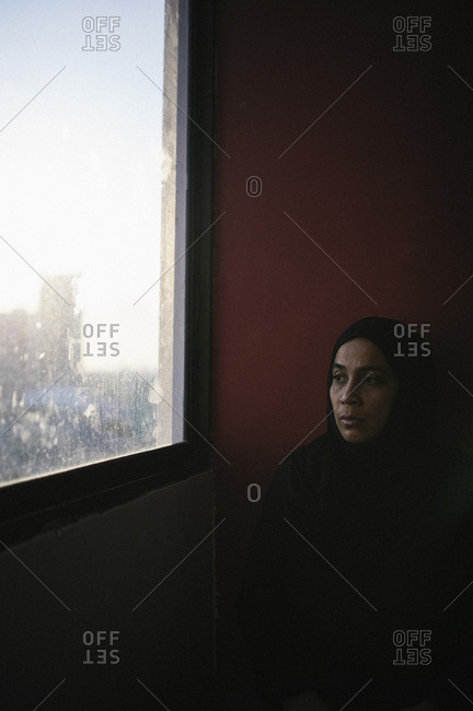 Malaysian woman looking out window