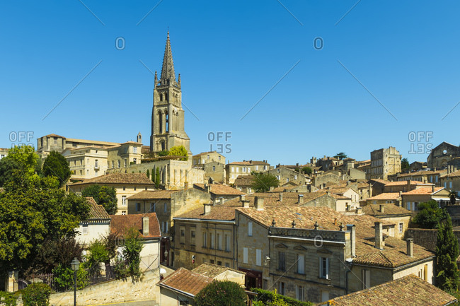 Saint Emilion, Gironde, France - August 21, 2015: The 53 metre bell tower of the 13th century church in this historic town and famous Bordeaux red wine region