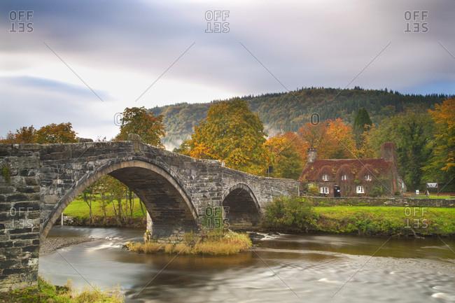 Clwyd, Snowdonia, North Wales, United Kingdom - October 21, 2010: Llanrwst Bridge (Pont Fawr)