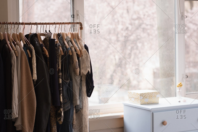 Clothes rack by glass window at home
