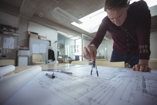 Architect working at desk in studio