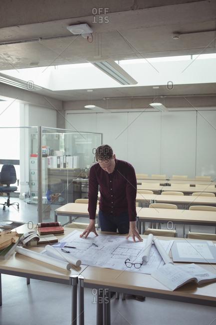 Architect working at desk in studio