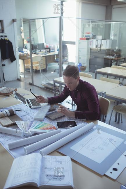 Attentive architect working table in studio
