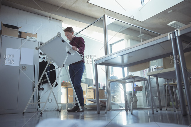 Architect working at drafting table in studio