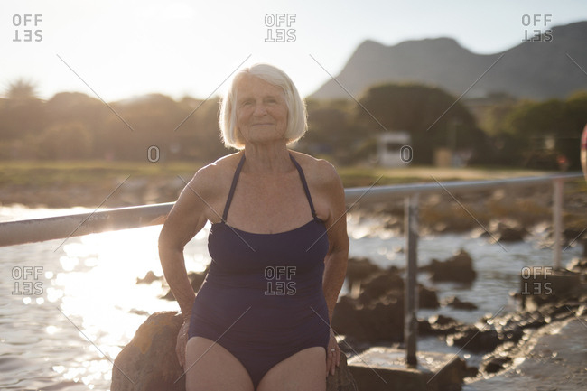 Senior woman in swimsuit standing on a sunny day