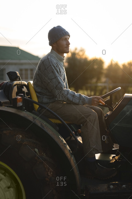 Farmer sitting on tractor on a sunny day