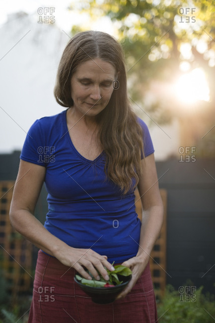 Portrait of woman holding a bowl in park