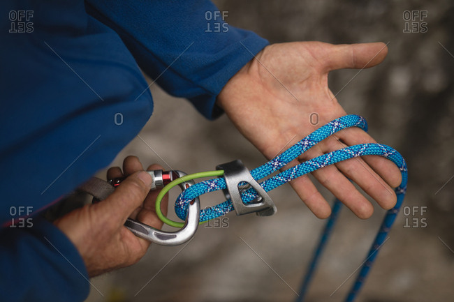 Close-up of hiker holding climbing rope