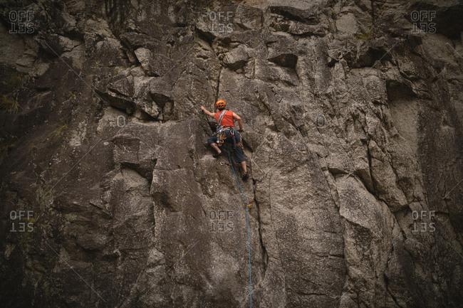 Rear view of man climbing mountain