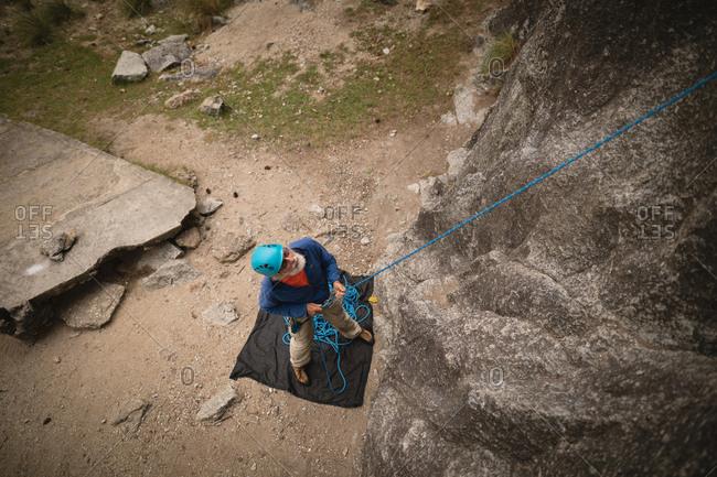 Overhead of man preparing for mountaineering