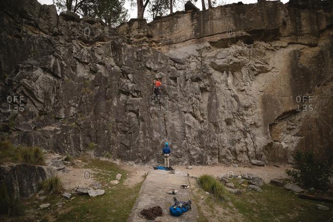 Rear view of men climbing mountain