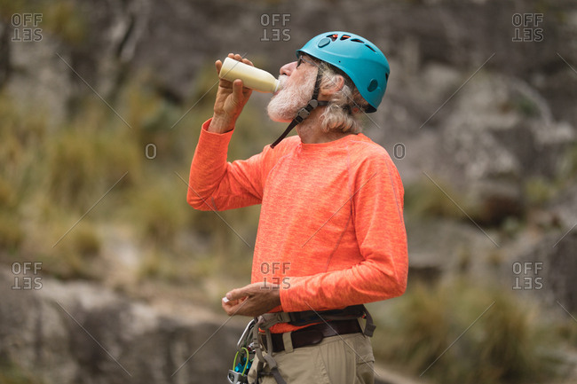 Senior man having energy drink while relaxing
