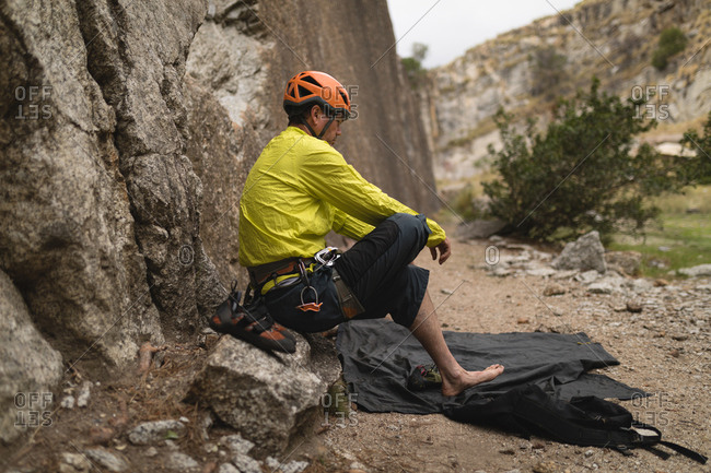 Determined man preparing for mountaineering
