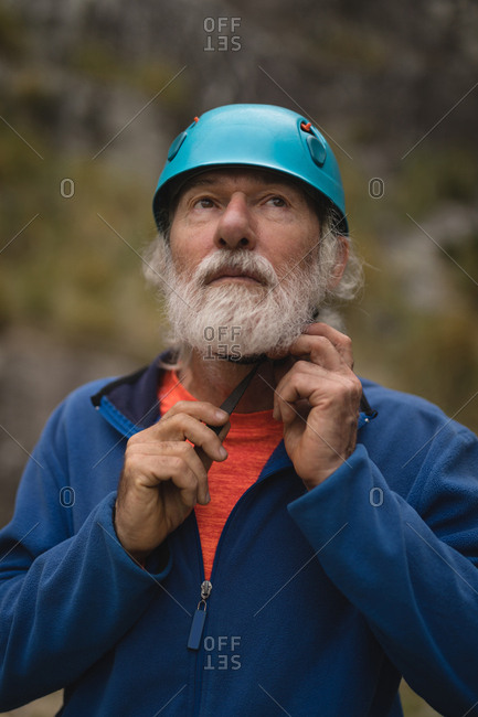 Close-up of senior man wearing protective helmet