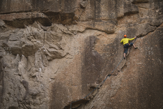 Rear view of man climbing mountain