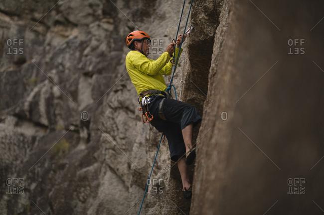 Determined man climbing mountain