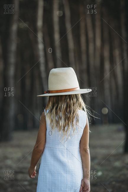 Girl in hat posing in woods