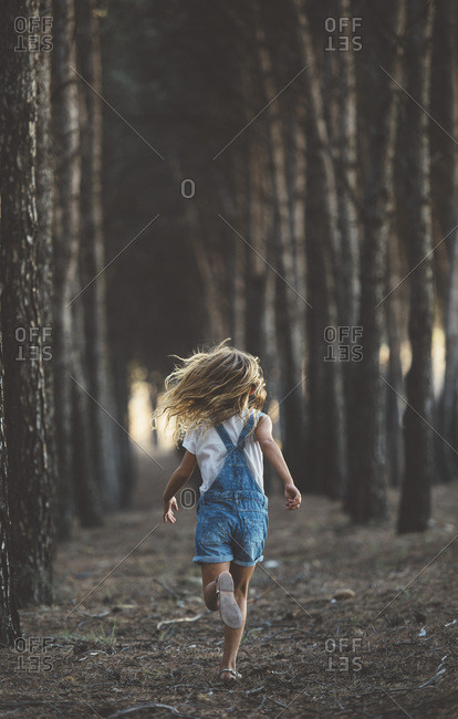 Happy child running in forest