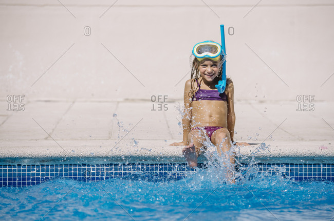 Kid playing in pool