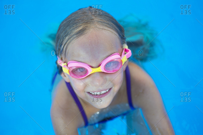 Kid in goggles in swimming pool