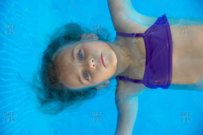 Kid floating in pool