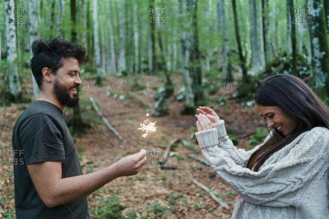 People with sparklers in woods