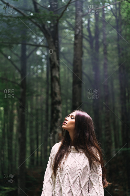 Woman posing in dark woods