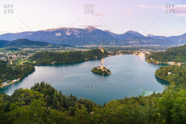 Aerial view to small island in lake in mountains