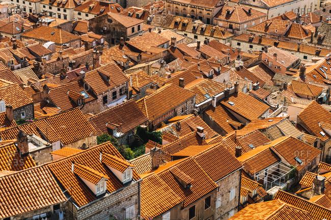 View of plenty of orange rooftops in old medieval city