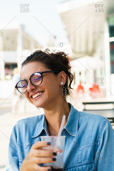 Woman posing sitting in outside cafe