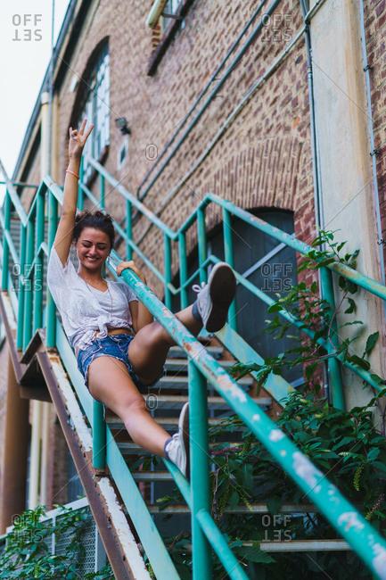 Woman posing on old stairway