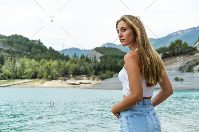 Content woman posing on shore