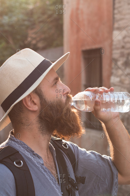 Man drinking water in the street