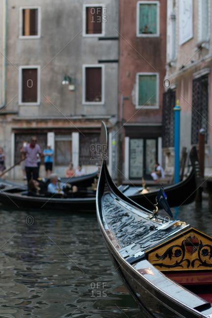 Gondolas floating in water of channel