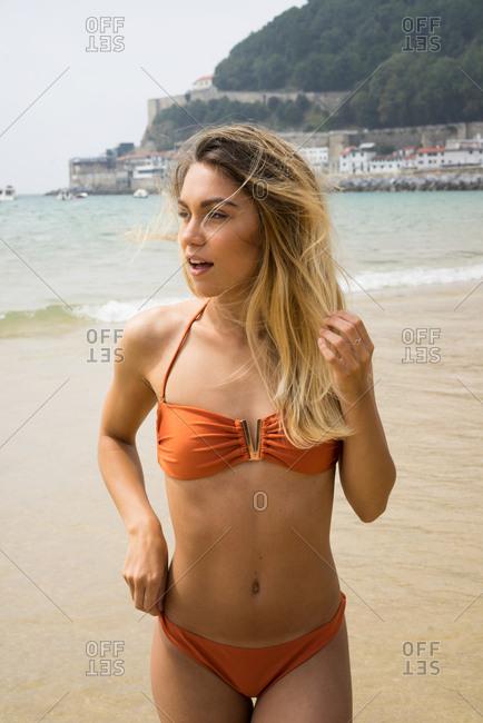 Slim girl in bikini on beach