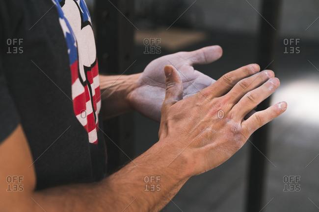Hands of bodybuilder in chalk