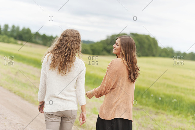Young women walking together - Offset