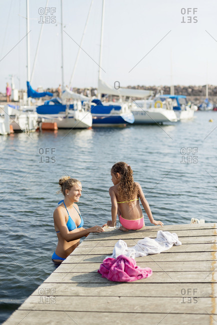Mother with daughter at jetty