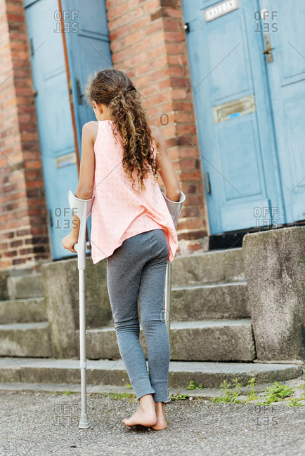 Girl walking on crutches