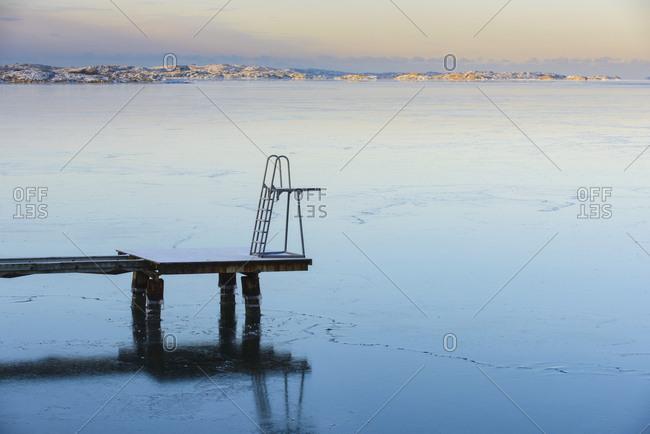 Jetty with swim ladder at sea