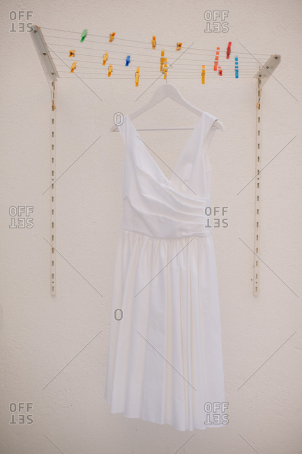 Wedding dress hanging from clothesline