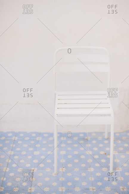 A white chair on tile