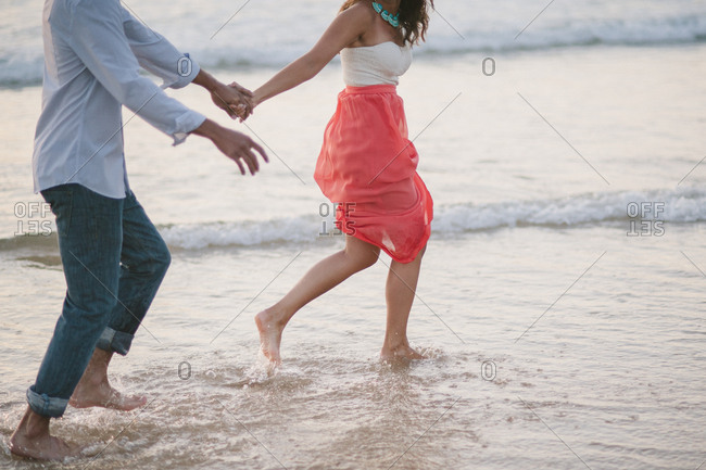 Loving couple being playful at a beach