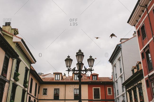 Streetlamp by residential buildings