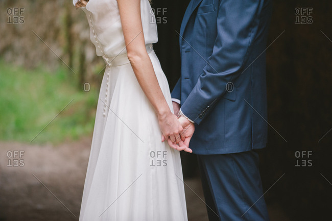 Bridal couple while holding hands