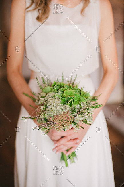 A bride and her floral bouquet