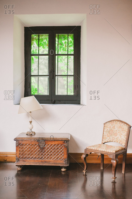 Antique chair and chest by window